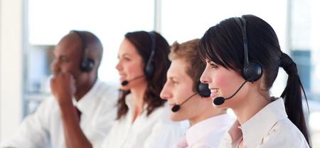Portrait of a joyful multi-ethnic sale representative team at work