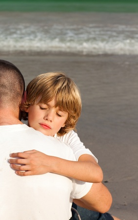 Portrait of a Young Boy Hugging his father  photo