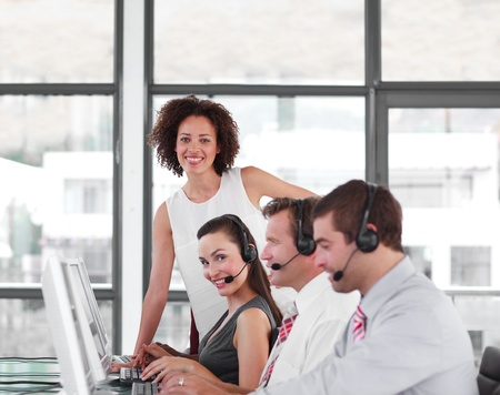 Serious female manager with her sale representative team Stock Photo - 10250314