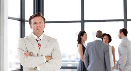 Attractive confident male manager leading his team Stock Photo - 10250086