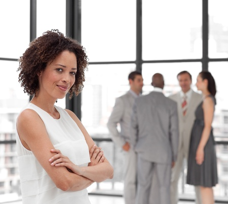 african american businesswoman: Smiling Businesswoman arms folded with his colleagues