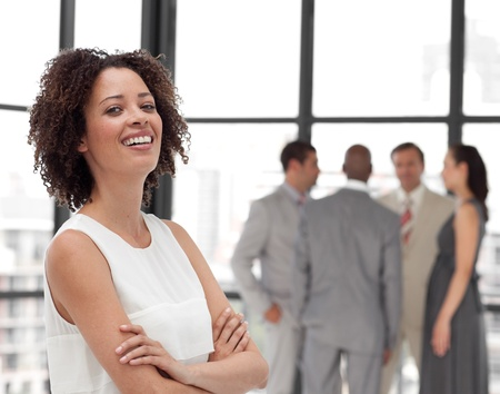 happy employee: Confident Businesswoman arms folded with his colleagues