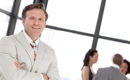 Smiling confident male manager leading his team Stock Photo - 10227291