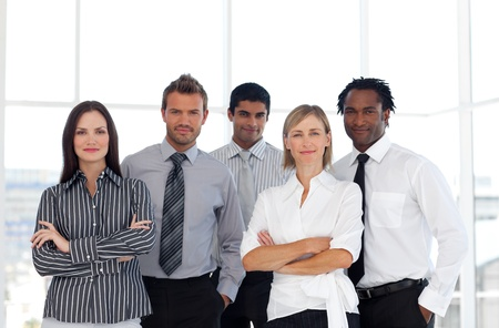 attire: Portrait of a cute group of business people looking at the camera Stock Photo