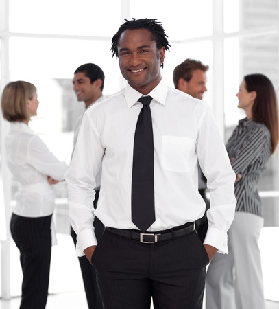 buisinessman: African male manager with his team Stock Photo