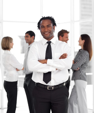 buisinessman: Confident male manager standing at the camera with his team