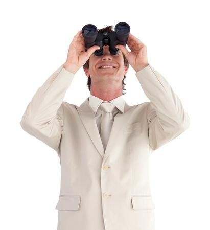 Mature businessman with binoculars  photo