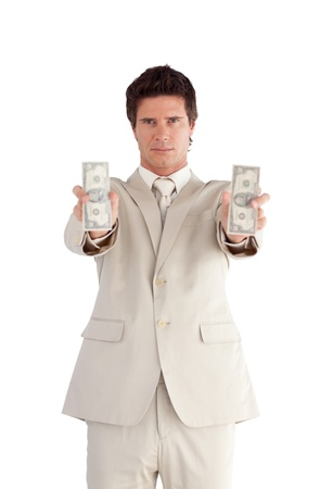 Young Attractive Businessman holding Dollars Stock Photo - 10233920