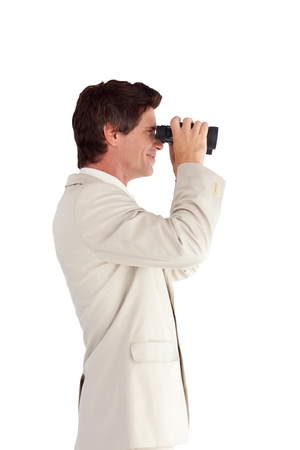 Portrait of an attractive businessman with binoculars photo