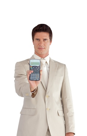 Smiling Businessman showing a calculator  photo