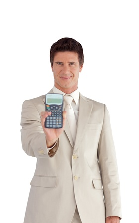 Handsome Businessman showing a calculator  photo