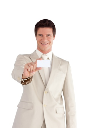 Positive businessman with a white card Stock Photo - 10249215