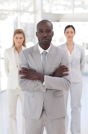 Serious afro-american manager with his team  photo