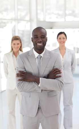 Smiling afro-american manager with his team  photo