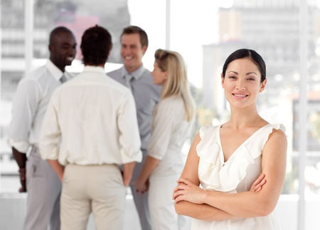 Cute people talking together at work photo