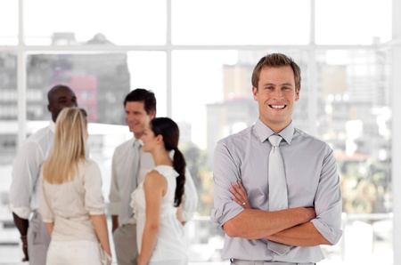 Positive people talking together at work photo