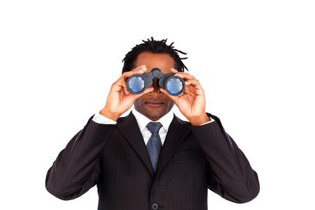 Cheerful business man using binoculars against a white background photo