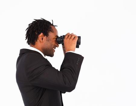 Afro-American businessman with binoculars photo