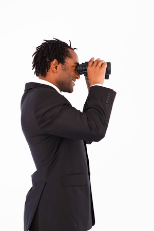 Serious Afro-American businessman with binoculars photo