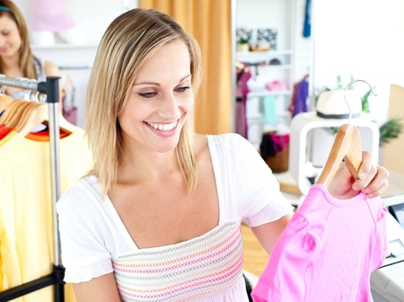 Bright woman selecting item  Stock Photo - 10233937