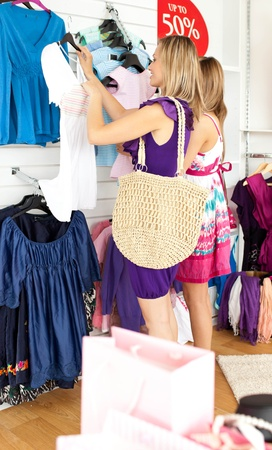 Two radiant women selecting item Stock Photo - 10247819
