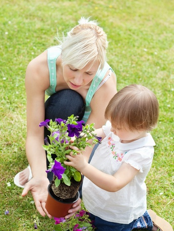 Caucasian Mother showing her daughter a purple flower  photo