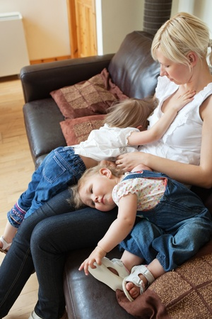 Smiling girl lying  on the sofa with her mother Stock Photo - 10248978