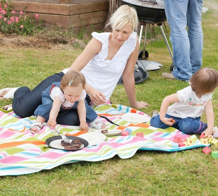 Mother and daughters having a picnic together photo
