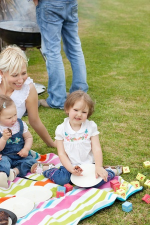 Caucasian family having a picnic together photo