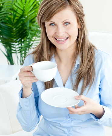 Bright businesswoman holding a cup Stock Photo - 10245932