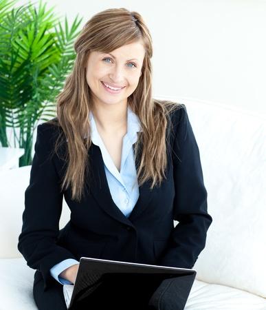 Beautiful businesswoman using a laptop Stock Photo - 10246846