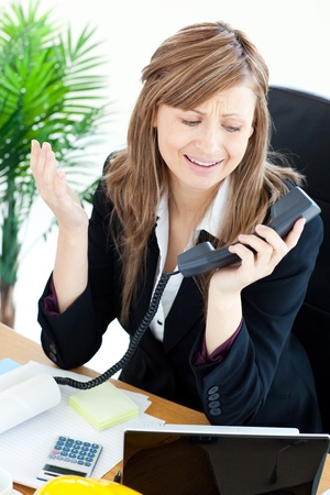 Assertive businesswoman on phone photo
