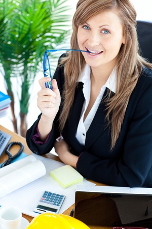 Serious businesswoman with glasses in a office Stock Photo - 10248939