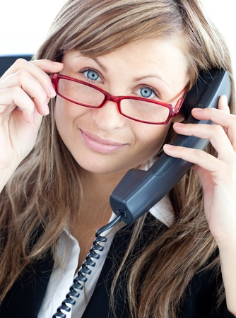 Attractive business woman on phone  wearing red glasses Stock Photo - 10248857