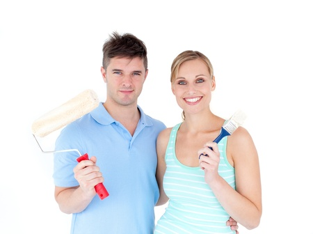 paintrush: Loving couple painting a room in their new house