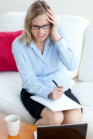 Angry businesswoman sitting on a sofa Stock Photo - 10250178