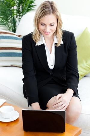 Charismatic businesswoman working at a laptop  Reklamní fotografie