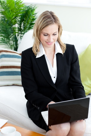 Beautiful businesswoman working at a laptop  photo