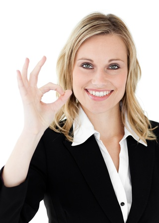Confident youngl businesswoman showing OK sign against a white background Stock Photo - 10249220