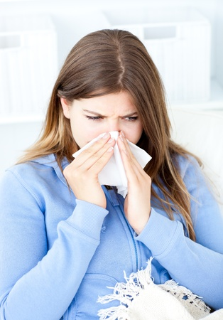 diseased: Sick woman sitting at home in her bed