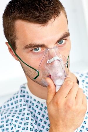 Patient having flu wearing a mask and looking at the camera Stock Photo - 10250399