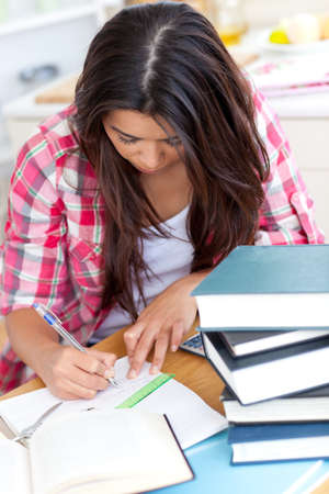 bored student: Young woman doing her homework  Stock Photo