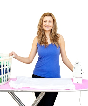 Beautiful woman behind an ironing board against white background photo