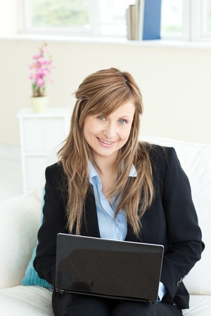 Sophisticated businesswoman using her laptop Stock Photo - 10249845