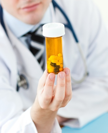 Young doctor holding pills Stock Photo - 10227288
