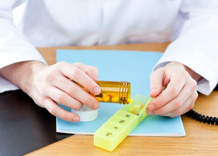 doctor giving pills: Close-up of a doctor giving pills to a patient  Stock Photo