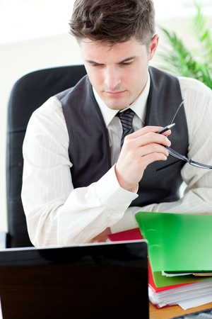 Worried male doctor looking at his laptop  Stock Photo - 10249864
