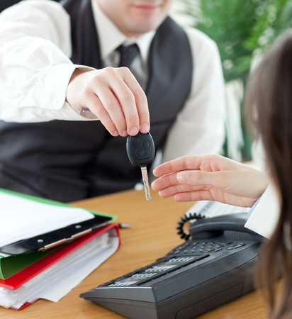 Young salesman giving car Reklamní fotografie