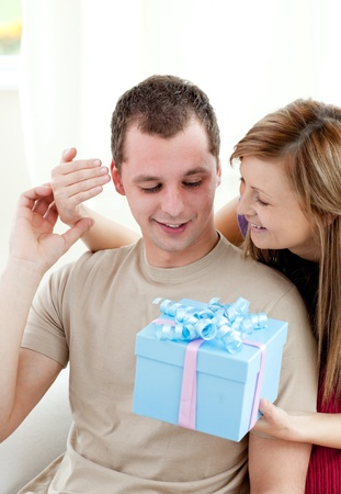 Smiling woman giving a present to her boyfriend  Stock Photo - 10248759