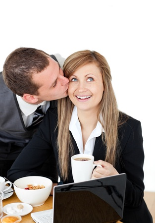 Attractive businessman kissing his bright girlfriend photo